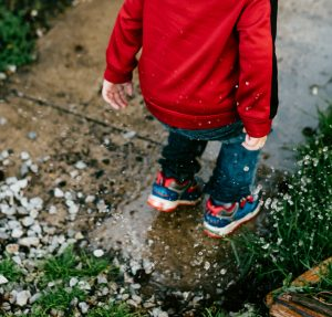 Stomping in puddles.