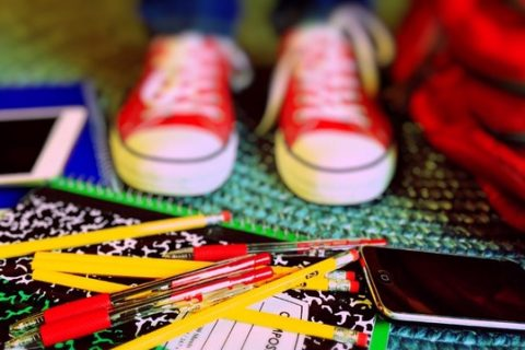 School supplies next to shoes