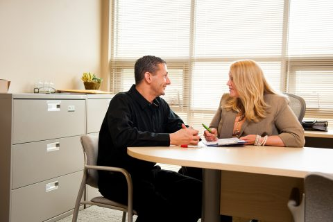 man chatting with business woman in the office